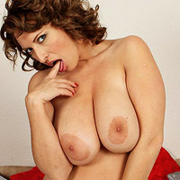 busty-milf-salinas-takes-off-her-yellow-sweater