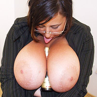 busty-office-babe-gya-plays-with-a-big-bottle-of-champagne