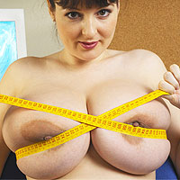 busty-office-brunette-scans-her-milky-tits