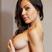 exotic-busty-brunette-shows-toned-body