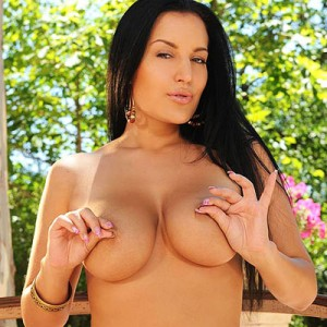 naturally-busty-carmen-croft-strips-outside