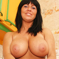 tanned-curvy-milf-kora-kyrk-in-the-kitchen