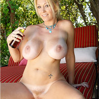 vivacious-blonde-charlee-chase-strips-by-the-pool